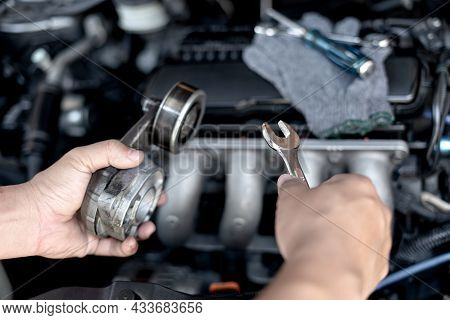 Wrench In The Hand Of A Technician For Take Off Belt Tension Pulley Old Part Car Engine Replacement