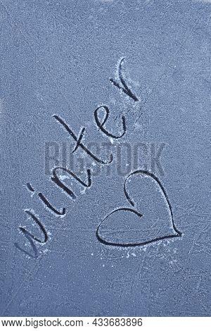 Winter. Frozen Glass Lettering.winter Word And Heart On Frozen Surface. Winter Season.