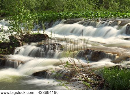 Rapids On The Suenga River. The Stone Bank Of A Mountain River, Washed-out Streams Of Water With Whi