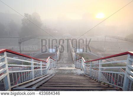 Descent To The Pedestrian Bridge Over The Railway Tracks Of The Trans-siberian Railway. Siberia, Rus