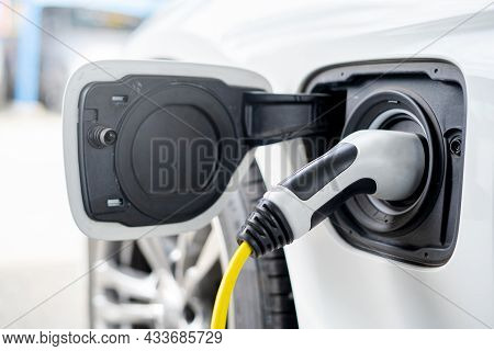 Old Electric Supply Plug For Electric Car With Power Supply In A Car Charging Station