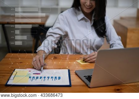 Business People Gather In A Corporate Location To Discuss Research Using Paperwork. Concept Of A Gro
