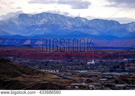 View of St. George Utah valley with Mormon LDS Temple red rocks and snow covered mountains