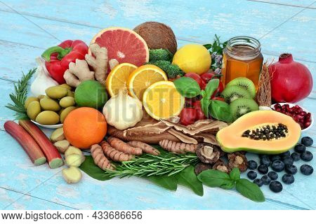Health food for immune system support with vegetables, fruit, honey, herbs and spice. Health foods very high in antioxidants, anthocayanins, protein, fibre, vitamins, lycopene, minerals and omega 3.