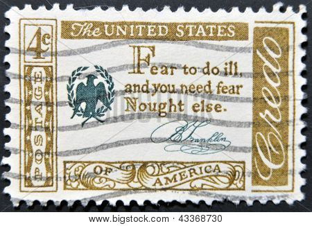 A stamp printed in USA shows Credo Fear to do ill and you need fear Nought