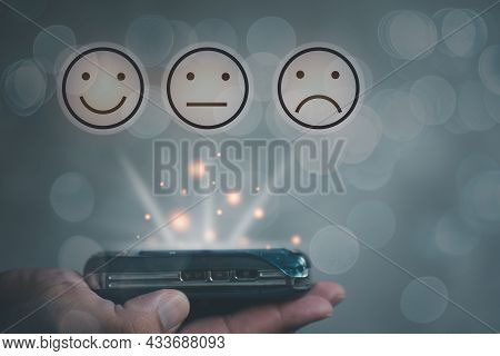 A Mobile Phone On Hand Show On The Virtual Screen With Feedback Rating. The Survey, Poll, Or Questio