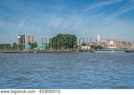 Rotterdam Netherlands - August 22 2021; Harbor Or River Barges Moored Alongside In River.