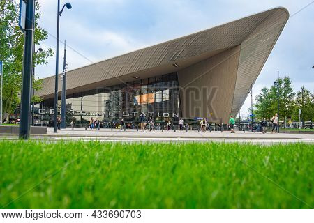 Rotterdam Netherlands - 24, 2017; Modernist Rotterdam Centraal Railway Station Green Lawn With Peopl