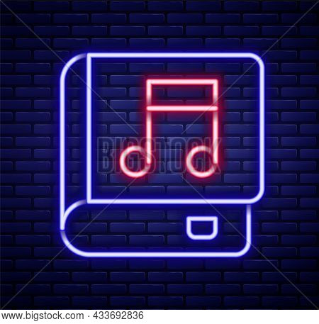 Glowing Neon Line Audio Book Icon Isolated On Brick Wall Background. Musical Note With Book. Audio G