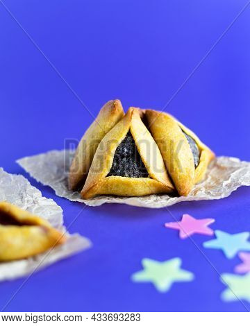 Traditional Jewish Triangular Hamantaschen Cookies With Poppy Filling. Purim Celebration Concept. Je