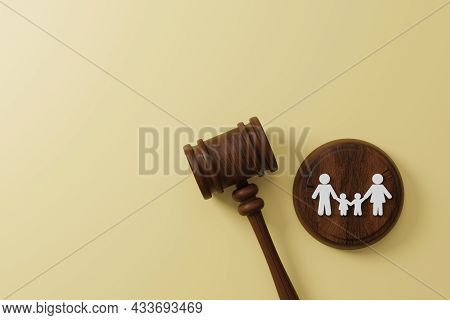 Top View Of Judge Gavel And Icon Human Family. Family Law Or Divorce, Legality, Adoption Concept. 3d