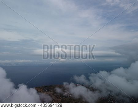 Abstract Aerial Nature Summer Ocean Sunset Sea And Sky Background. Natural Sky With Puffy Stratocumu