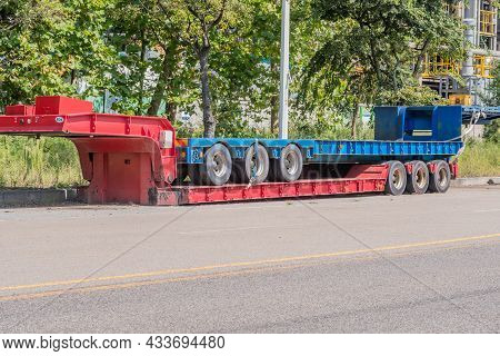 Pyeongteak, South Korea; September 13, 2021: Two Flatbed Trailers Parked On Side Of Road In Urban In