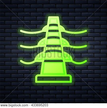Glowing Neon Electric Tower Used To Support An Overhead Power Line Icon Isolated On Brick Wall Backg