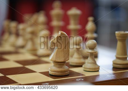 Chess Piece - The White Knight Starts The Game. The Concept Of An Unusual Start To A Chess Game And