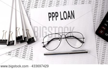 Ppp Loan Text On Paper With Chart And Office Tools , Business