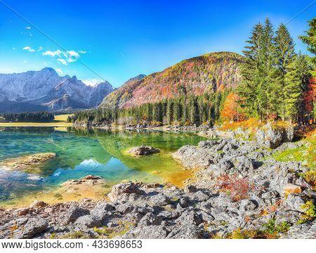 Fairytale View Of Fusine Lake With Mangart Peak On Background. Popular Travel Destination Of Julian
