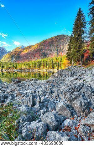 Fantastic View Of Fusine Lake With Mangart Peak On Background. Popular Travel Destination Of Julian