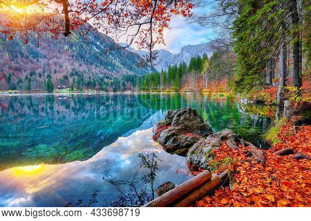 Breathtaking View Of Sunset Over Fusine Lake With Mangart Peak On Background. Popular Travel Destina