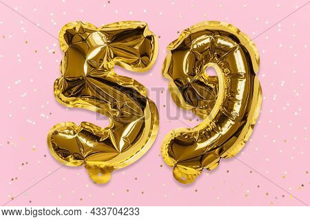 The Number Of The Balloon Made Of Golden Foil, The Number Fifty-nine On A Pink Background With Sequi