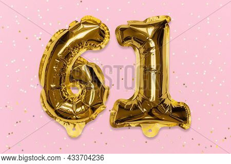 The Number Of The Balloon Made Of Golden Foil, The Number Sixty-one On A Pink Background With Sequin