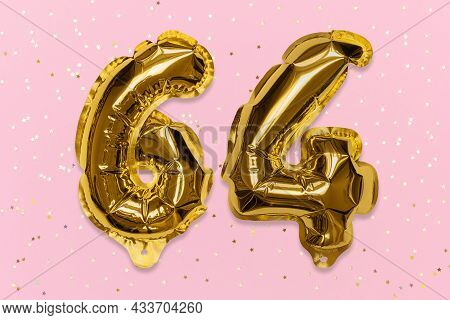 The Number Of The Balloon Made Of Golden Foil, The Number Sixty-four On A Pink Background With Sequi