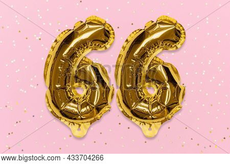 The Number Of The Balloon Made Of Golden Foil, The Number Sixty-six On A Pink Background With Sequin