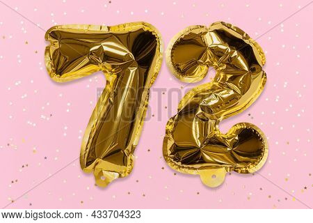 The Number Of The Balloon Made Of Golden Foil, The Number Seventy-two On A Pink Background With Sequ