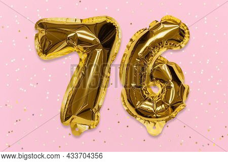 The Number Of The Balloon Made Of Golden Foil, The Number Seventy-six On A Pink Background With Sequ