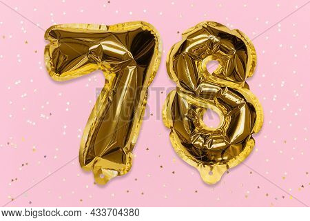 The Number Of The Balloon Made Of Golden Foil, The Number Seventy-eight On A Pink Background With Se