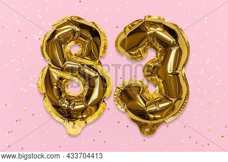 The Number Of The Balloon Made Of Golden Foil, The Number Eighty-three On A Pink Background With Seq