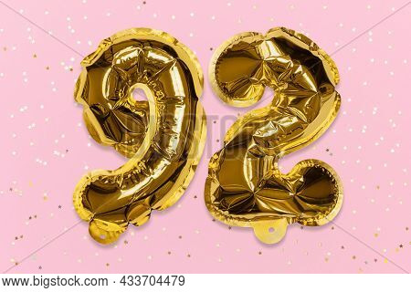 The Number Of The Balloon Made Of Golden Foil, The Number Ninety-two On A Pink Background With Sequi