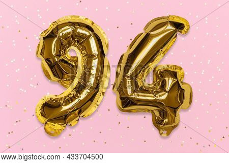 The Number Of The Balloon Made Of Golden Foil, The Number Ninety-four On A Pink Background With Sequ