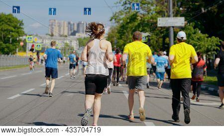 Slow Motion Marathon Runners On City Road