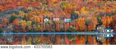 Panoramic view of Saint-Jean-des-Piles village surrounded with bright fall foliage in Quebec, Canada