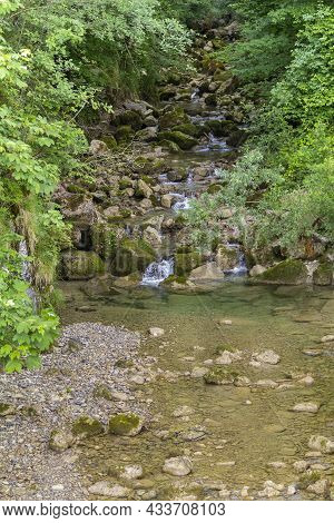 Small River Including Lots Of Stones At The Allgaeu Region In Swabia, Germany