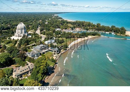 Wilmette, IL - September 9, 2021: Aerial view of the Baha'i Temple and Wilmette Harbor along the Lake Michigan shoreline in Wilmette, IL on a beautiful later summer day.