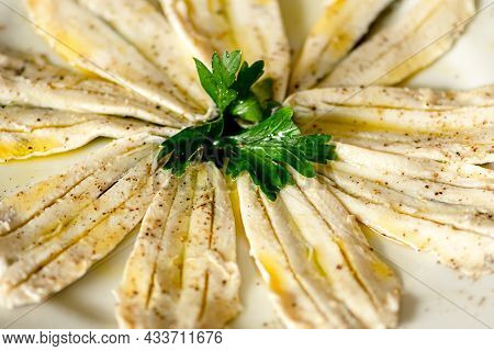 Marinated Anchovies With Vinegar, Olive Oil, Pepper And Parsley, In A Plate, Close Up