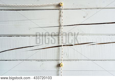 Retro Wiring In A Wooden House, White Twisted Cable Goes Outside The Wooden Beam