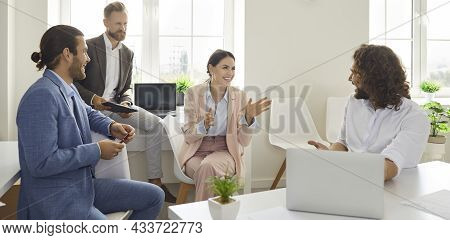 Friendly Colleagues Who Have Good Relationship Have Pleasant Conversation In Office During Break.