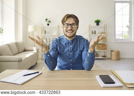 Cheerful Male Company Manager Conducts Online Meetings With His Clients Using Webcam.