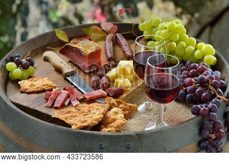 Wine Tasting In South Tyrol With A Hearty Snack Consisting Of Bacon, Salami, Mountain Cheese And Cru