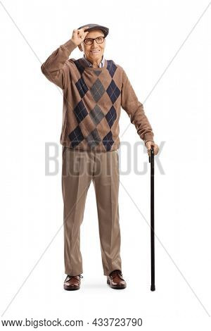 Senior man with a walking cane greeting with hat isolated on white background
