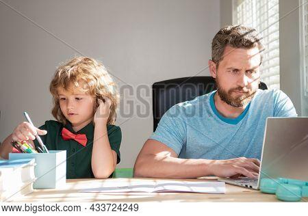 Mature Man Teacher Or Dad Helping Kid Son With School Homework On Computer, Homeschooling