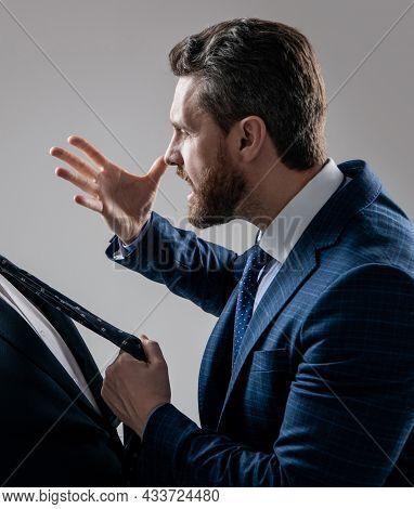 Aggressive Lawyer In Suit Make Threaten Gesture Pulling Man Necktie Grey Background, Threatening