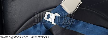 Safety Belts Lying On Passenger Seat Of Aircraft Closeup
