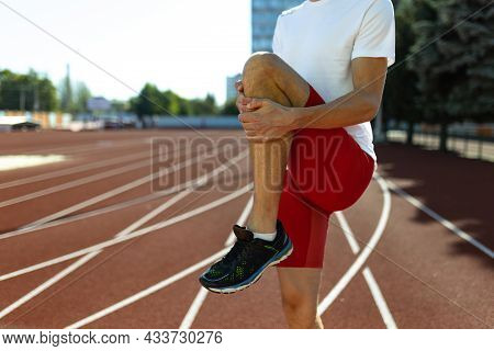 Cropped Image Of Male Athlete, Runner Training At Public Stadium, Sport Court Or Running Track Outdo