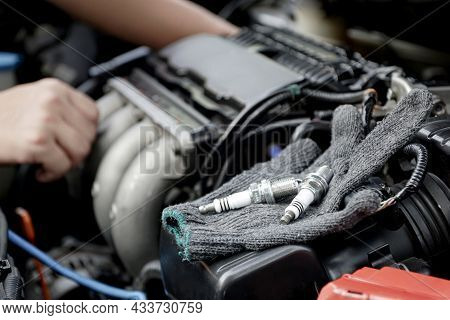 Cloth Gloves And Car Spark Plug On Engine,technician Service And Repairing Service Concept Of Car