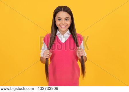 Happy Teen Girl On Yellow Background. Childhood Happiness. Back To School.