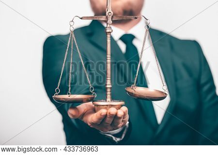 Weight scale of justice, lawyer in background. Justice, law, attorney, authority concept